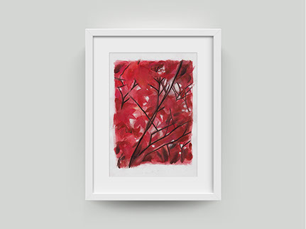 Painting of a red tree in white frame on wall